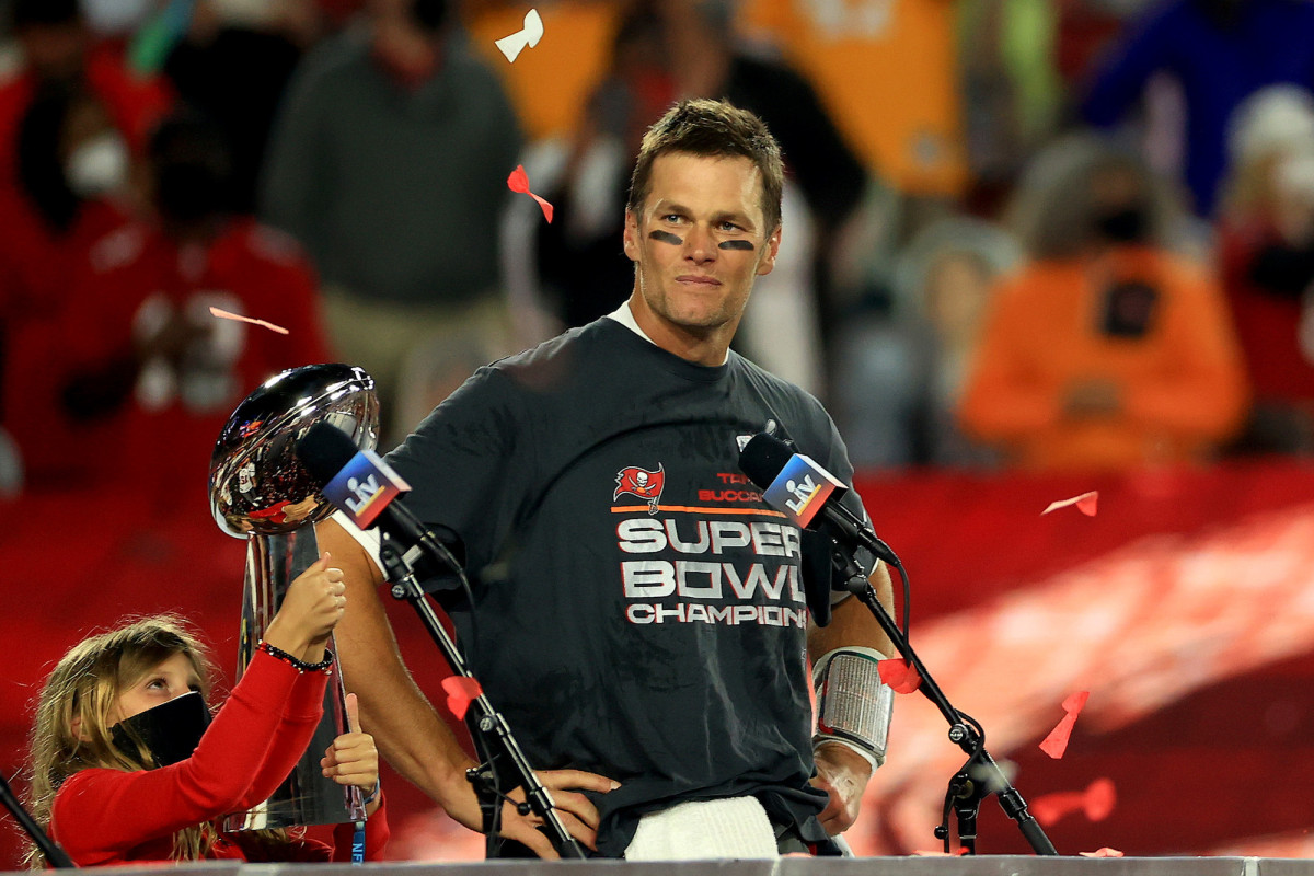 Tom Brady accepting the Lombardi Trophy after helping his team win Super Bowl LV.