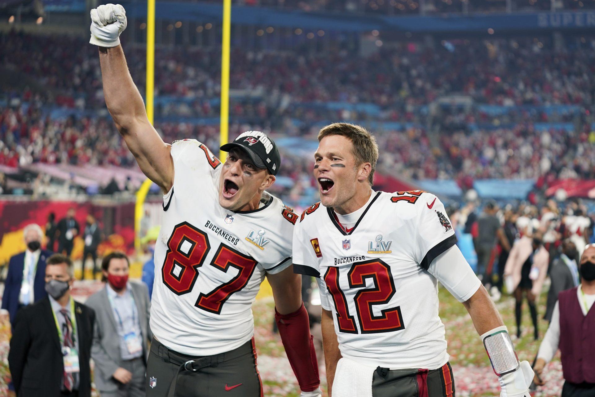Teammates Rob Gronkowski and Tom Brady celebrate their Super Bowl LV win.