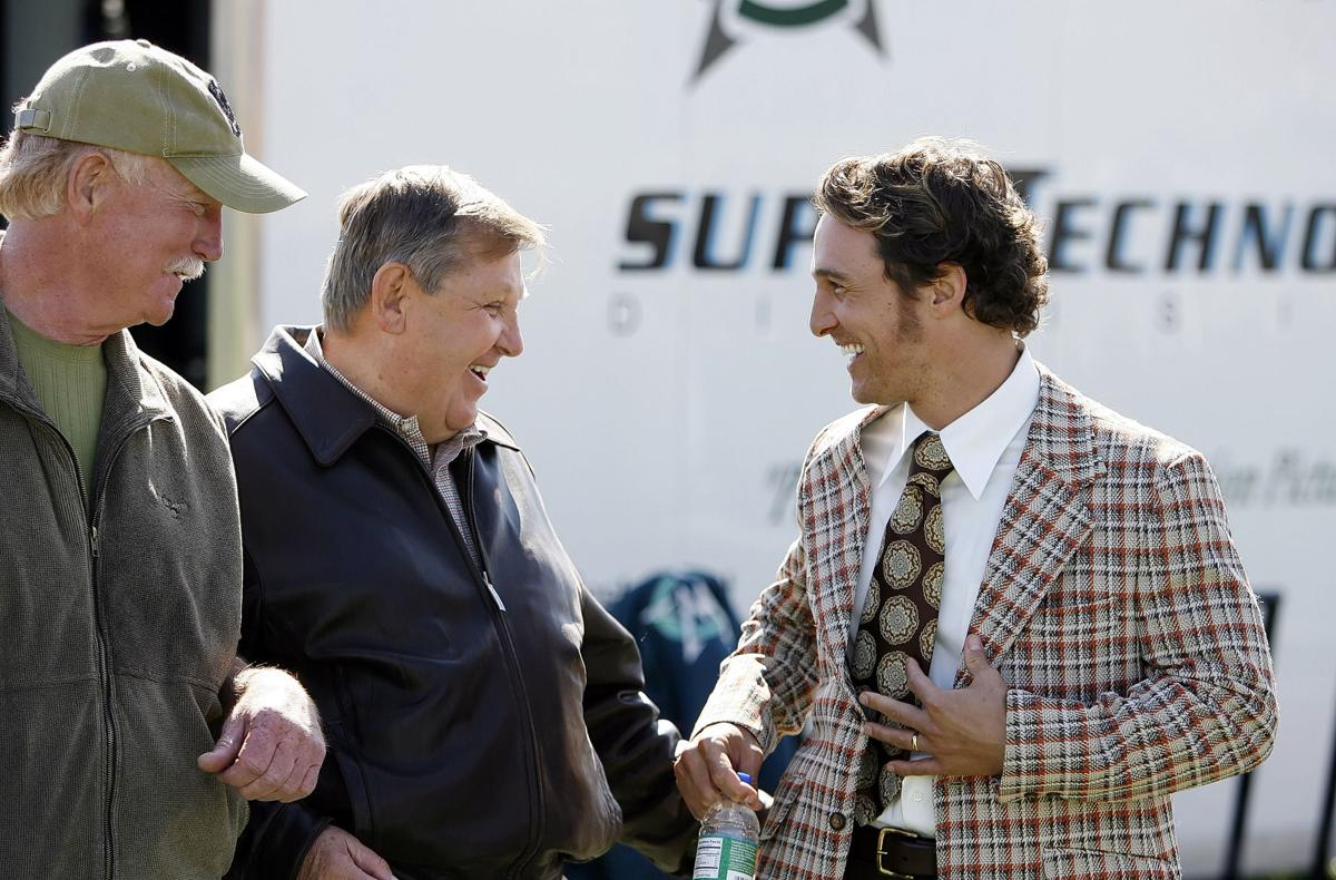 Matthew McConaughey having a conversation with coach Jack Lengyel
